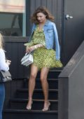 Miranda Kerr in a short dress leaving an office in New York City