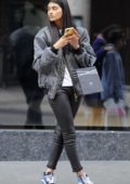 Neelam Gill busy on her phone while out in London