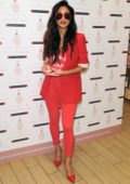Nicole Scherzinger dressed in all red while promoting her new perfume CHOSEN at the Trafford Centre in Manchester, UK