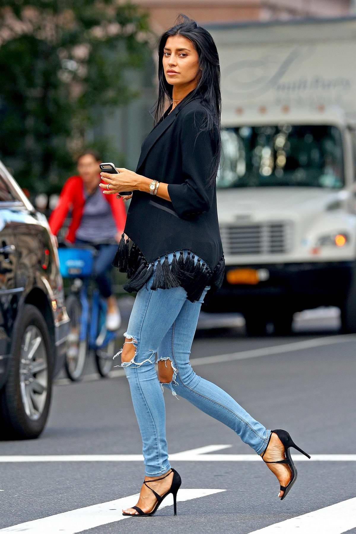 Nicole Williams wears a tasseled blazer and ripped jeans while out running a few errands in-between fittings during New York Fashion Week