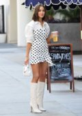 Olivia Culpo in a polka dotted dress enjoying a cool drink in Los Angeles