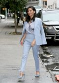 Olivia Munn in a baby blue suit arrives at The Daily Show in New York City