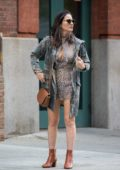 Olivia Munn wearing a leopard print dress and camo jacket as she arrives at her hotel in New York