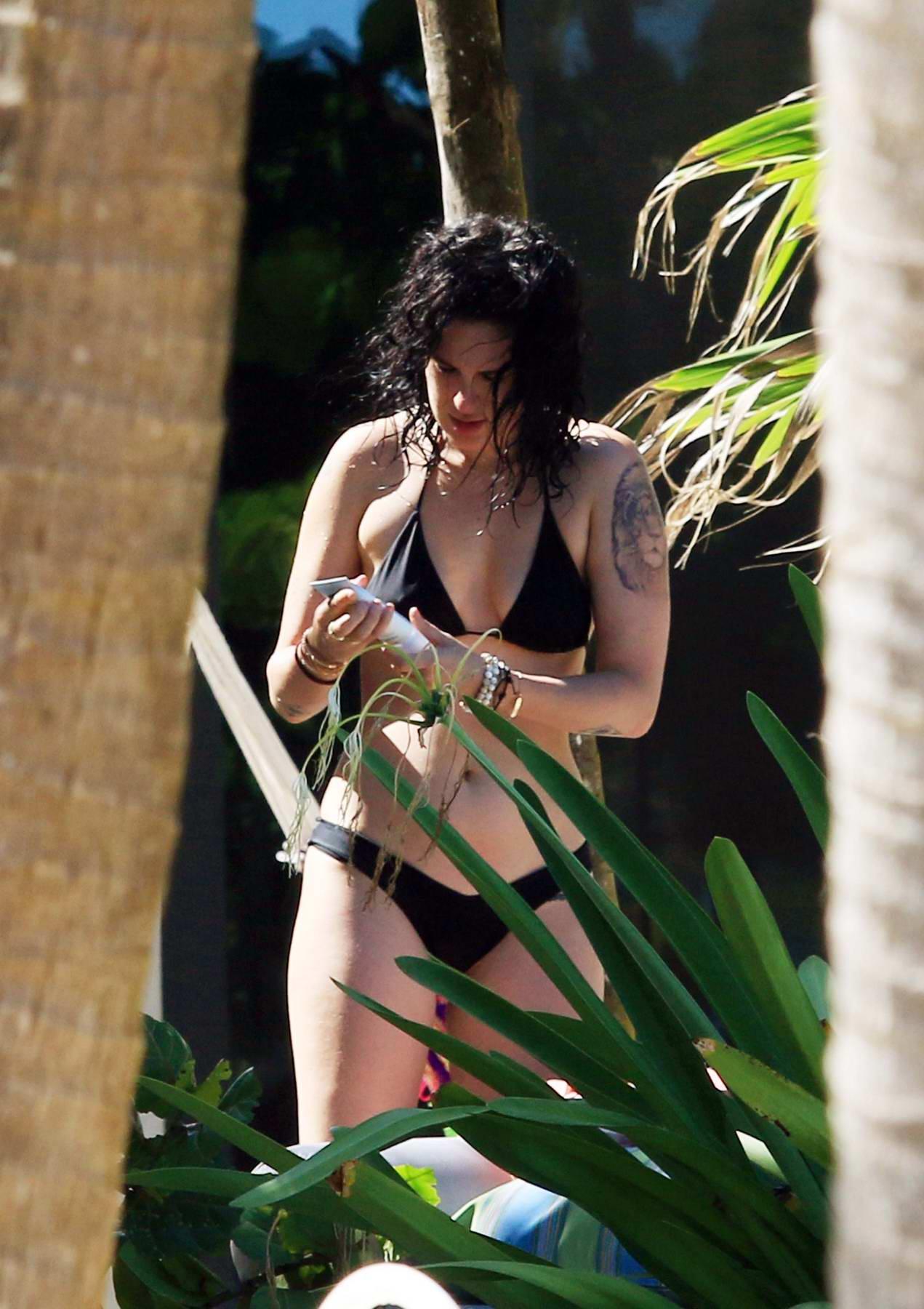 Rumer Willis in a black bikini relaxing on the beach in Tulum, Quintana Roo, Mexico