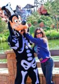 Salma Hayek poses with the character Dingo during a visit to Disneyland in Paris, France