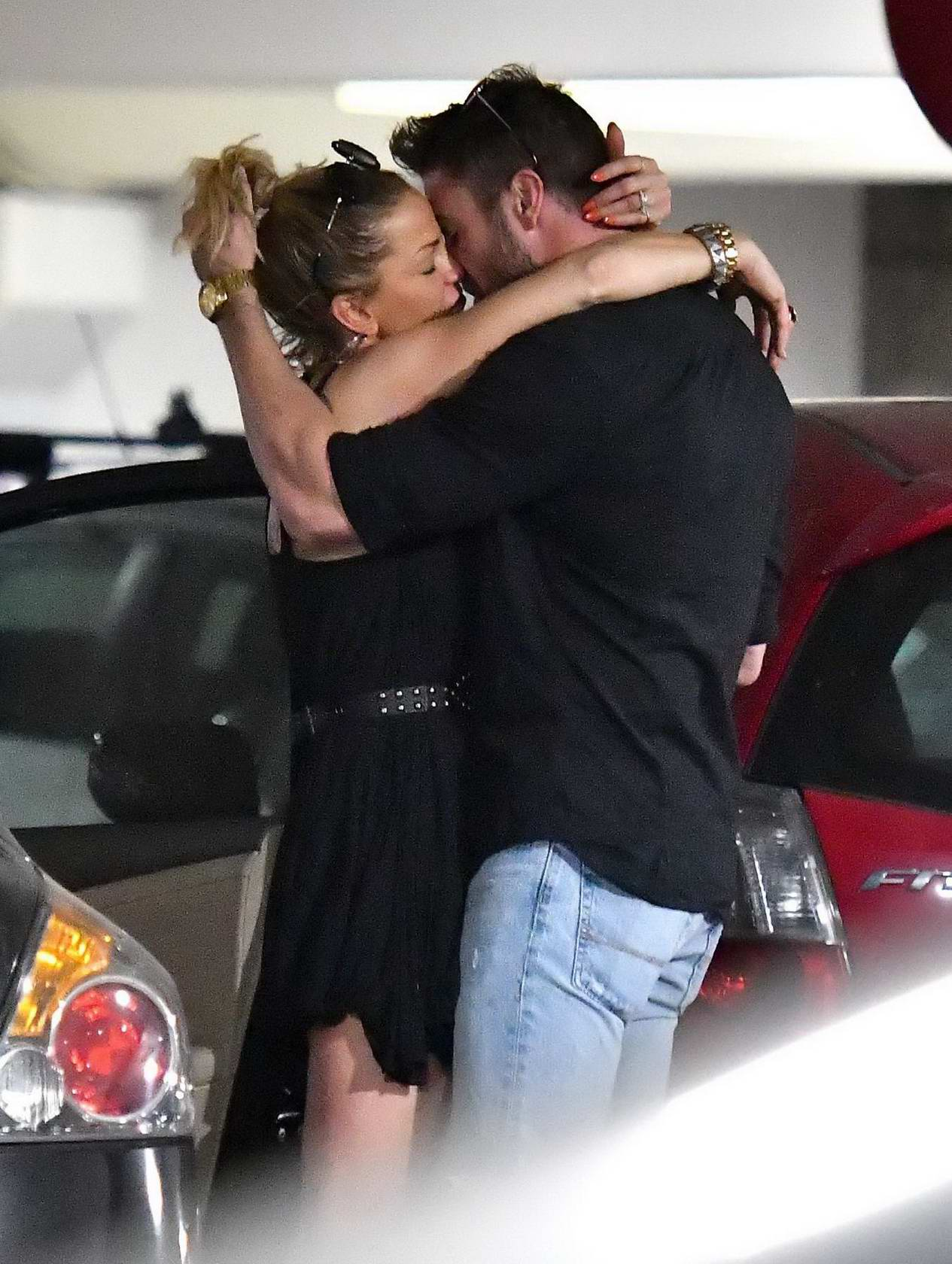 Sarah Harding shares a kiss with Chad Johnson as she lands in Los Angeles