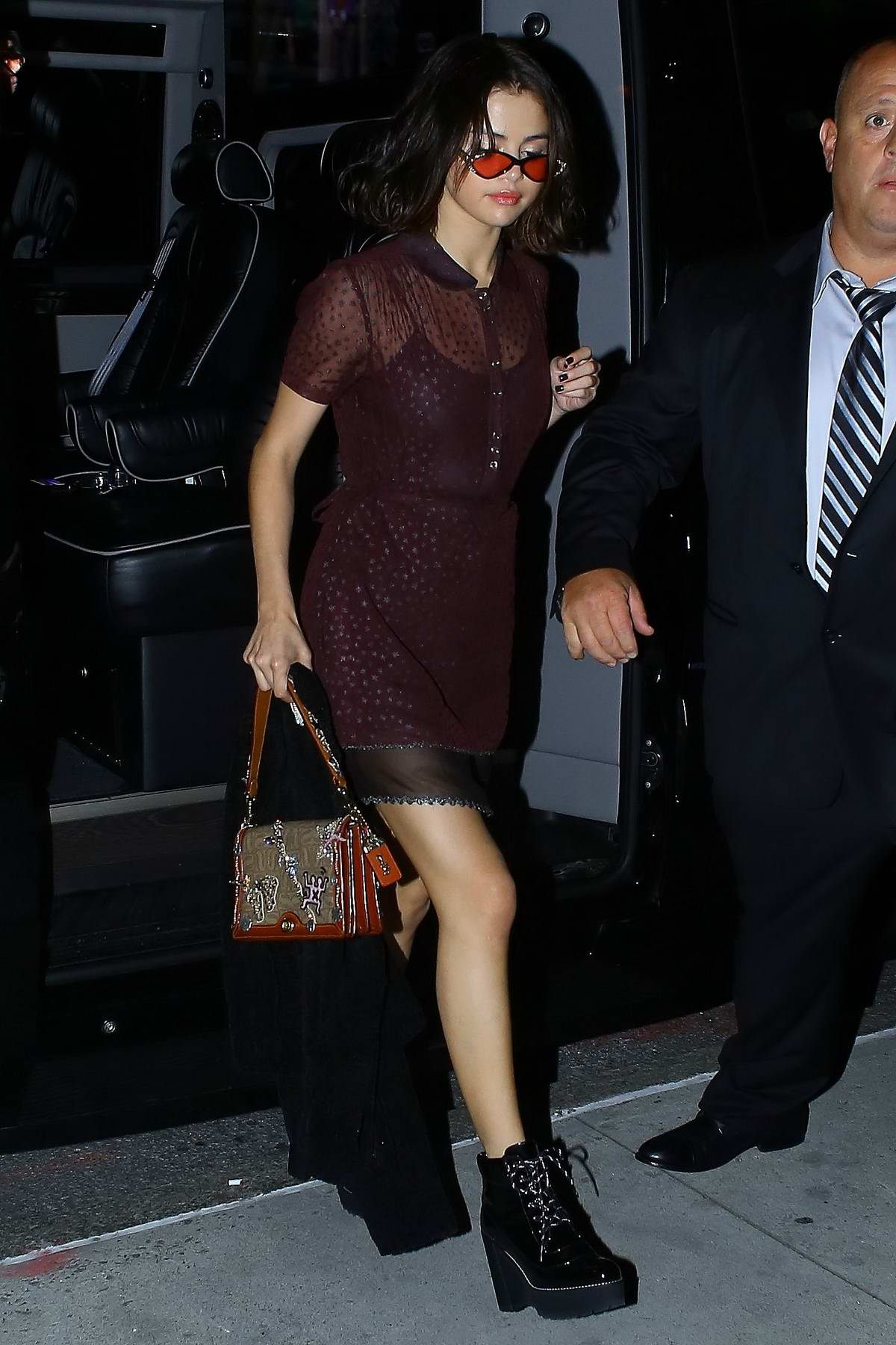 Selena Gomez arriving at her apartment in New York