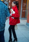 Selena Gomez carries her new puppy out in New York City