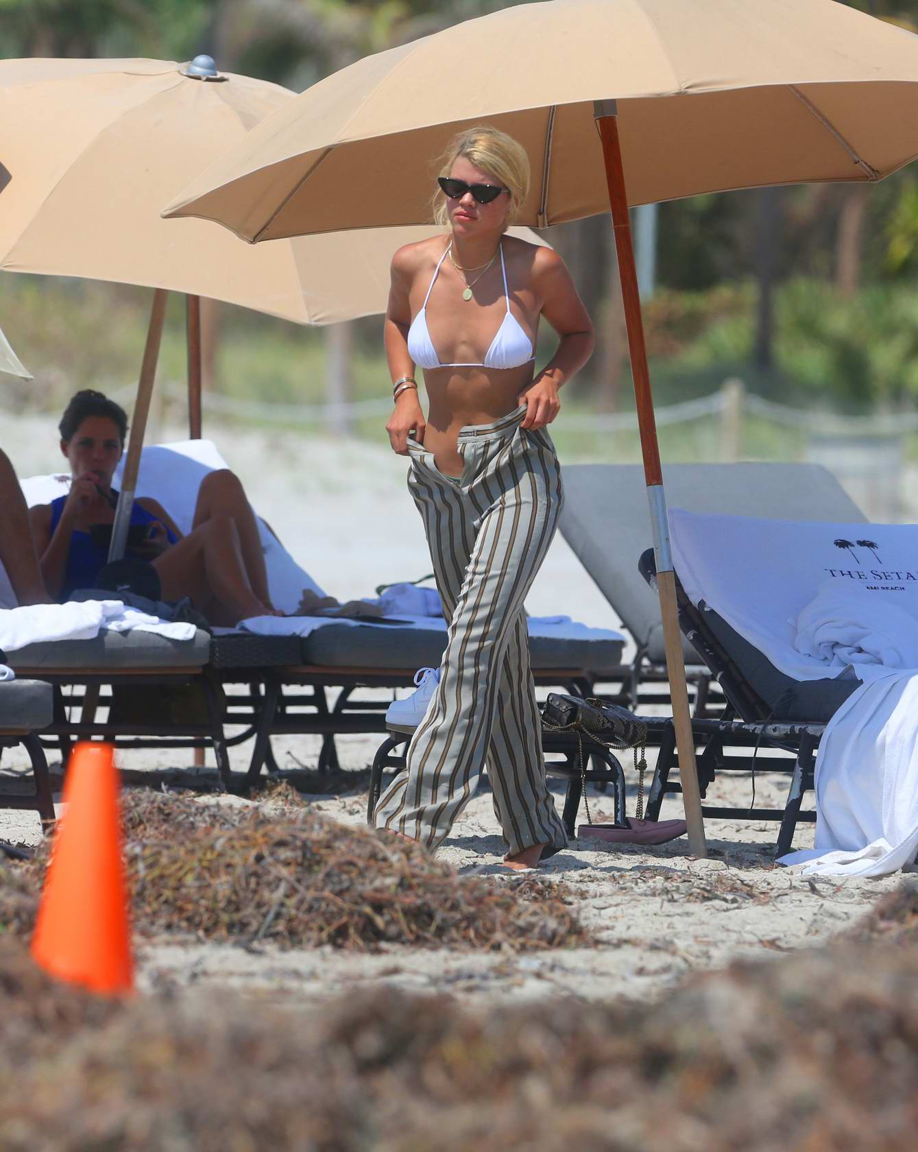 Sofia Richie and Scott Disick spotted relaxing by the poolside in Miami