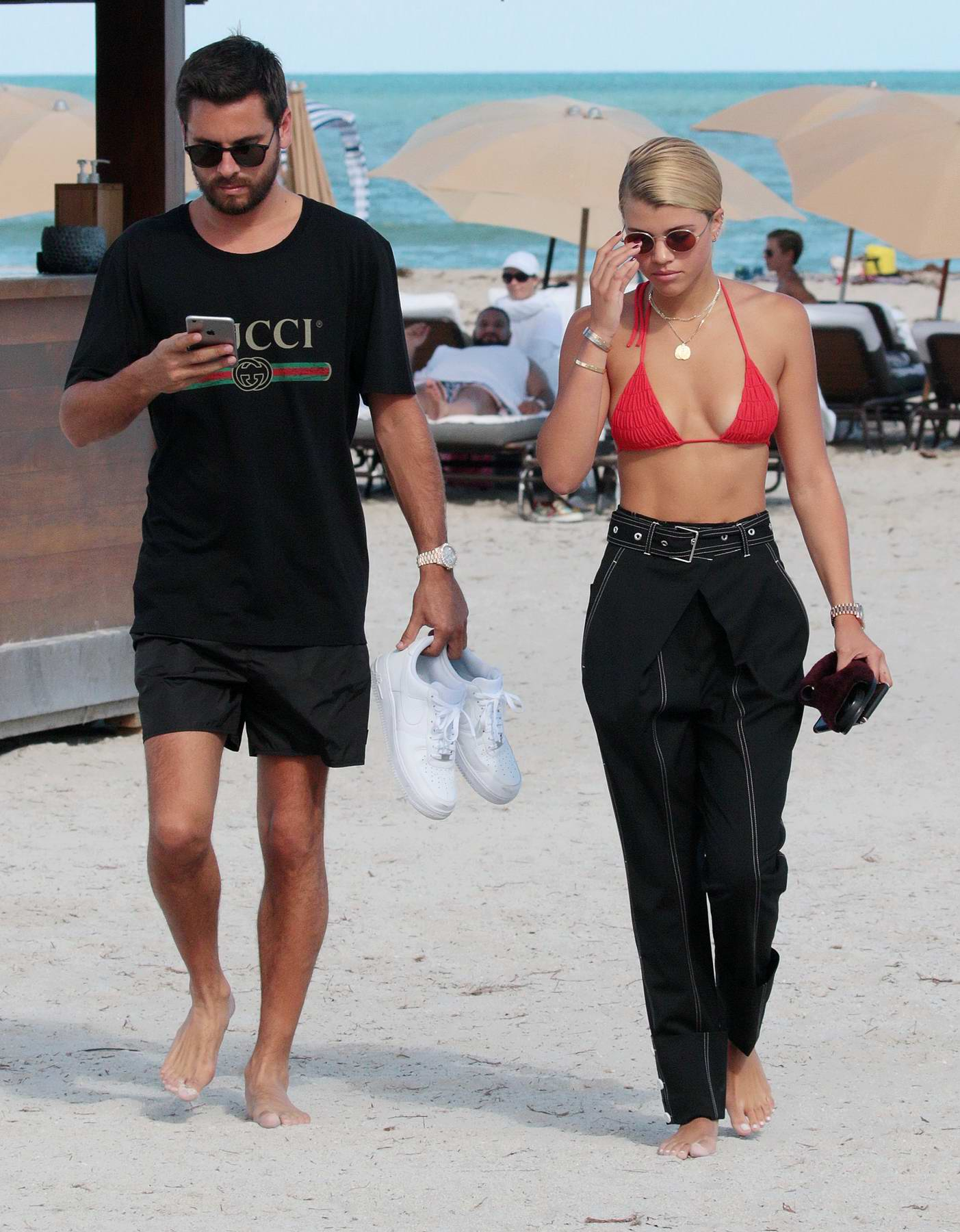sofia richie in a red bikini top taking a walk with scott disick by the beach in miami-230917_#
