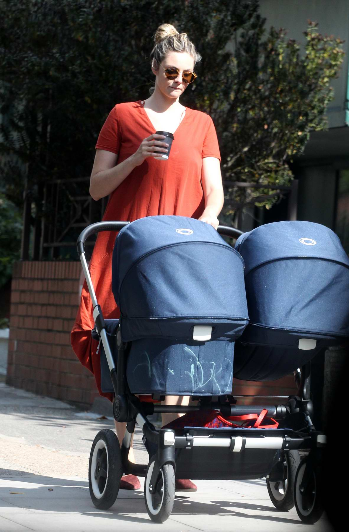 Tamsin Egerton out for a walk with a baby pram in North London