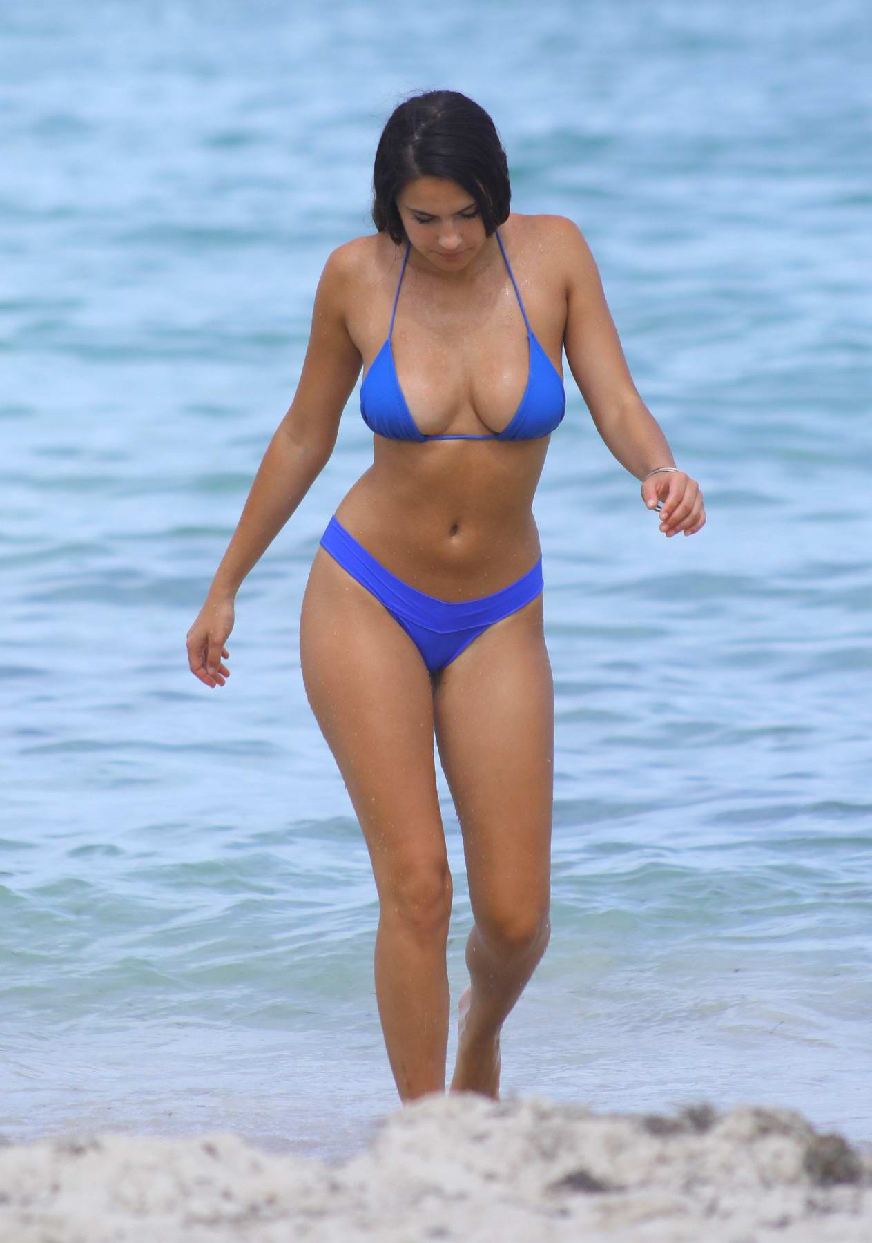 Tao Wickrath in a blue bikini relaxing at the beach in Miami