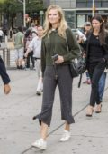Toni Garrn grabs coffee and go for a walk with friends in Central Park, New York City