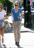 Toni Garrn wearing a blue t-shirt with matching blue leather bag while out in the West Village, New York City