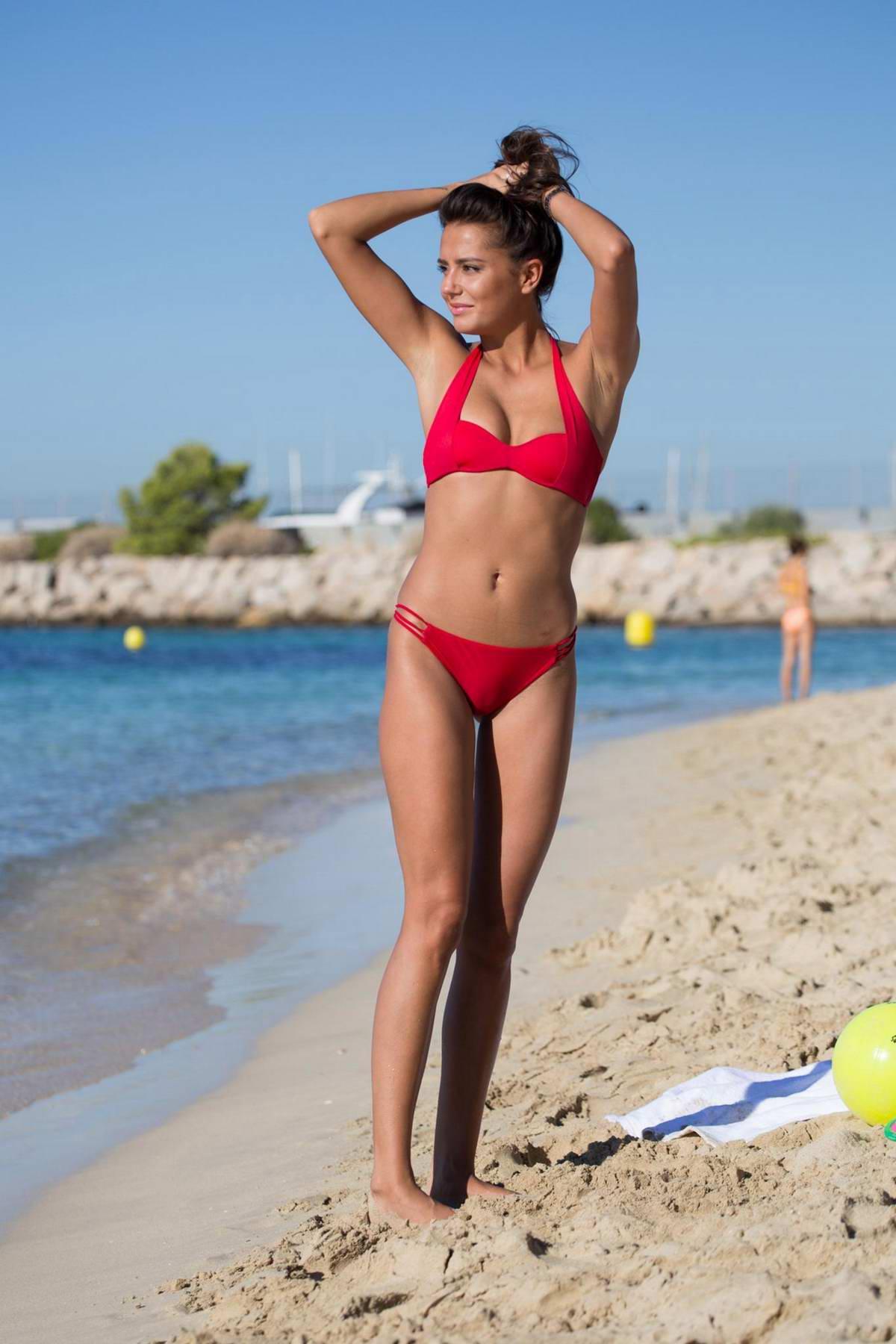 Tyla Carr in a red bikini enjoying the beach in Mallorca, Spain