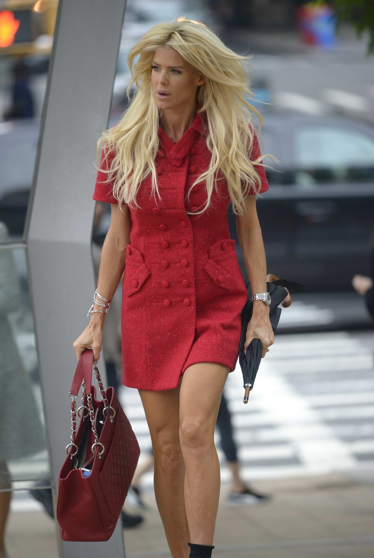 Victoria Silvstedt in a red short dress arriving at the Lincoln Center in New York