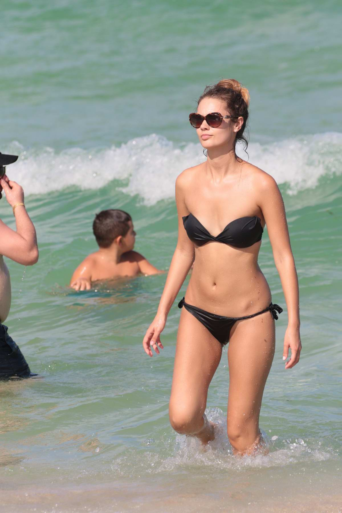 Yana Dubnik in a black bikini at the beach in Miami