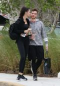 Adriana Lima packs on the PDA with boyfriend Metin Hara as they share a kiss on their way to the gym in Miami, Florida