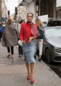 Alessandra Ambrosio in a red sweater with a matching scarf and denim skirt while out and about in Paris, France