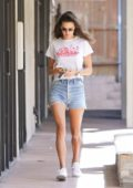 Alessandra Ambrosio in a white Marchin' T-shirt and denim shorts is spotted running errands in Los Angeles