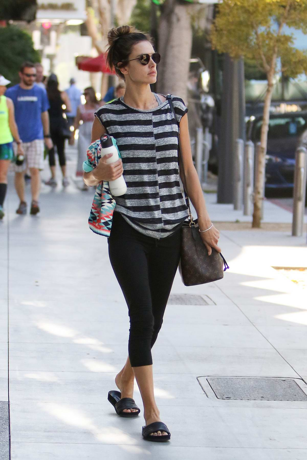 Alessandra Ambrosio walks to her car after leaving a workout in Los Angeles