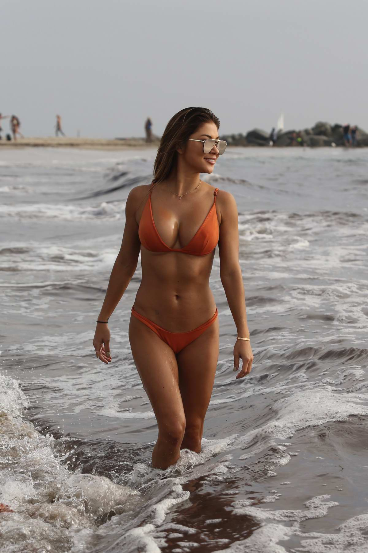Arianny Celeste in an orange bikini spotted at the beach in Venice, California