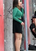 Ashley Graham takes a cigarette break while on the set of her new reality TV show filming in Miami, Florida