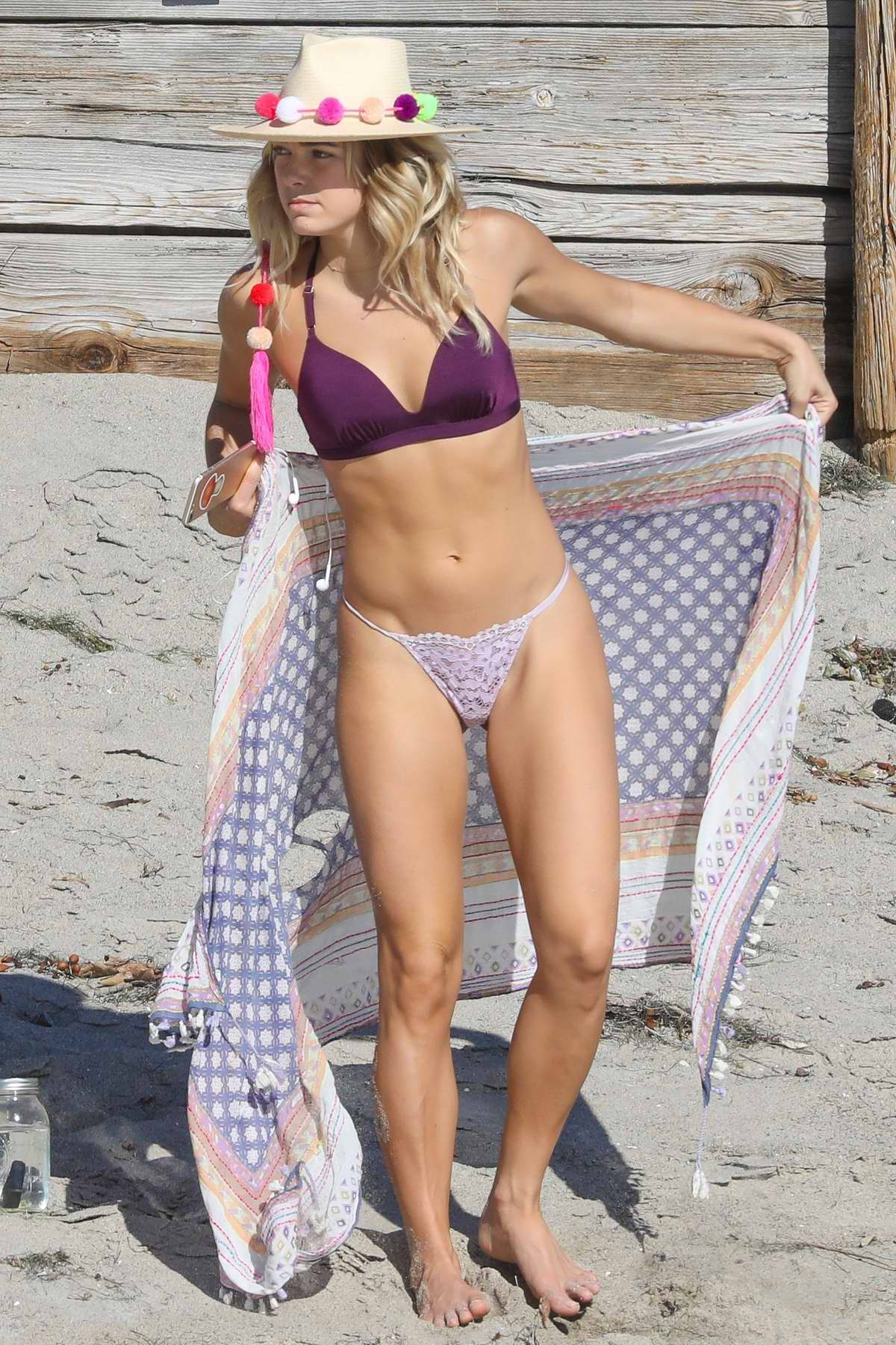 Ashley Hart in a bikini on set of a photoshoot for Athleta on the beach in Malibu, California