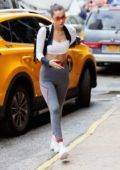 Bella Hadid in a white top and grey leggings head out in New York City