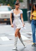Bella Hadid wears a white dress paired with knee high boots on her birthday while out in New York