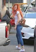 Bella Thorne in a white tee and blue jeans out with her friend in Los Angeles