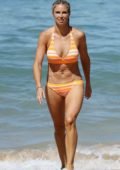 Ironwoman Candice Warner in a bikini while out on the beach in Coogee, Australia