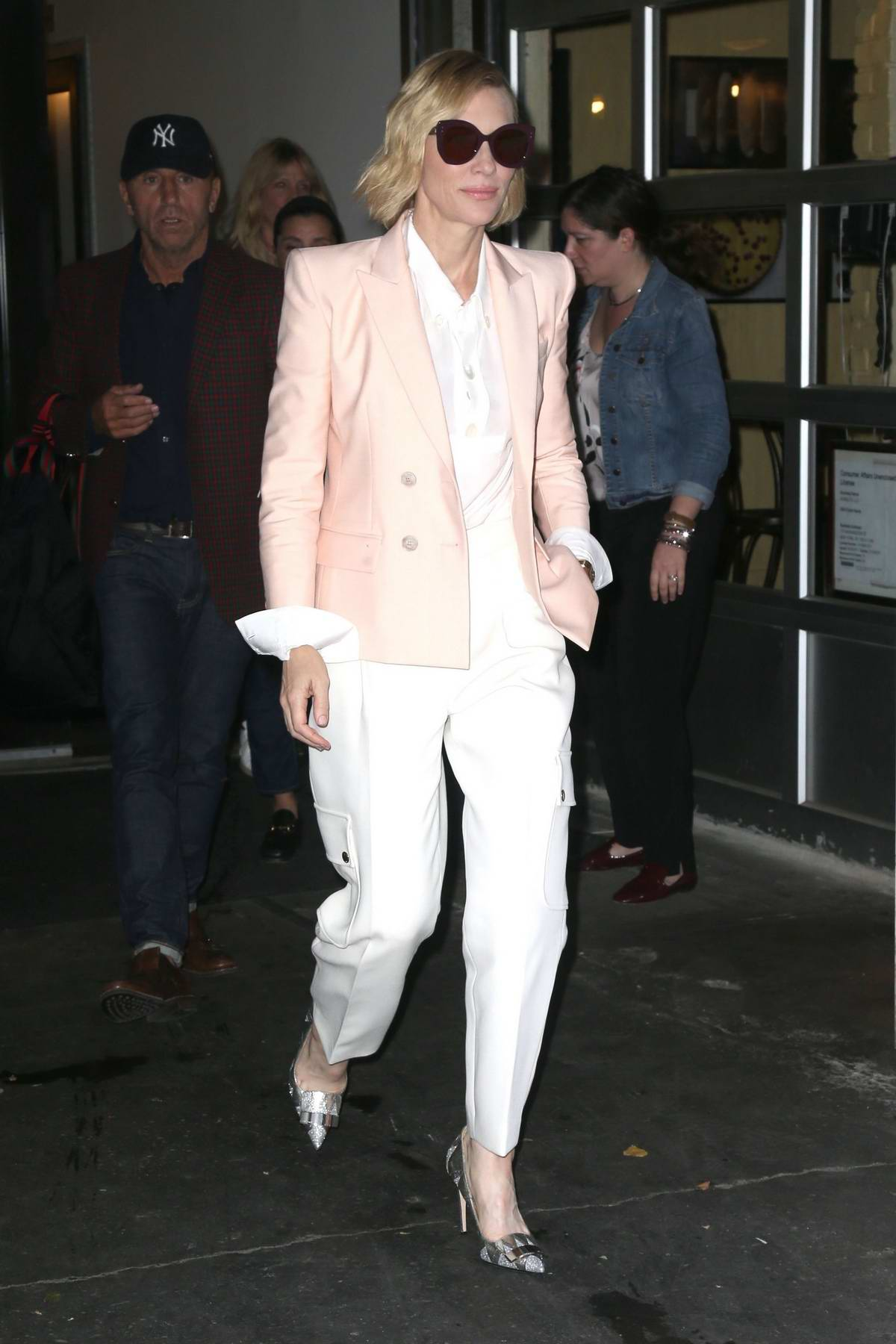 Cate Blanchett dressed in pastel pink and white suit leaving her hotel in New York City