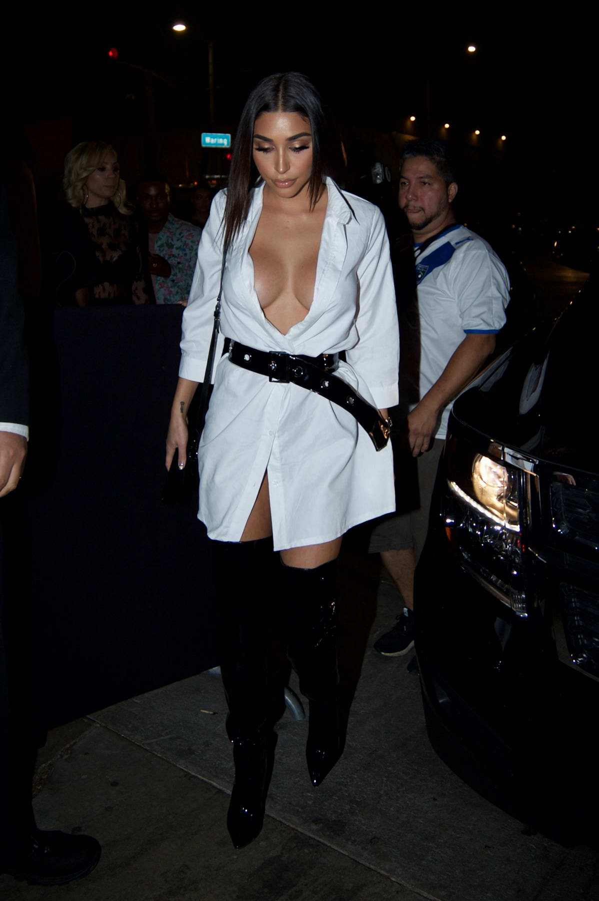 Chantel Jeffries in a white coat arrive at the Poppy nightclub in West Hollywood, Los Angeles