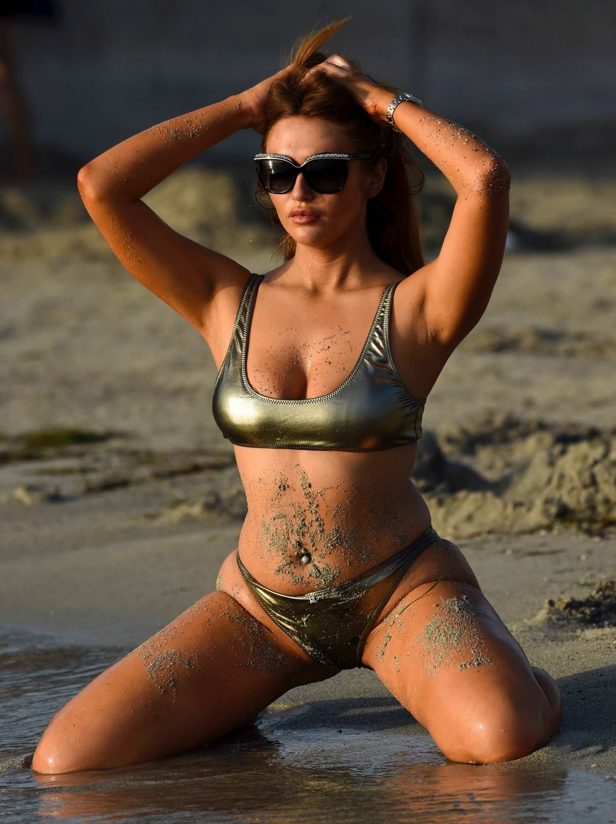 Charlotte Dawson in a bikini enjoys the sun at the beach while on holiday in Majorca, Spain