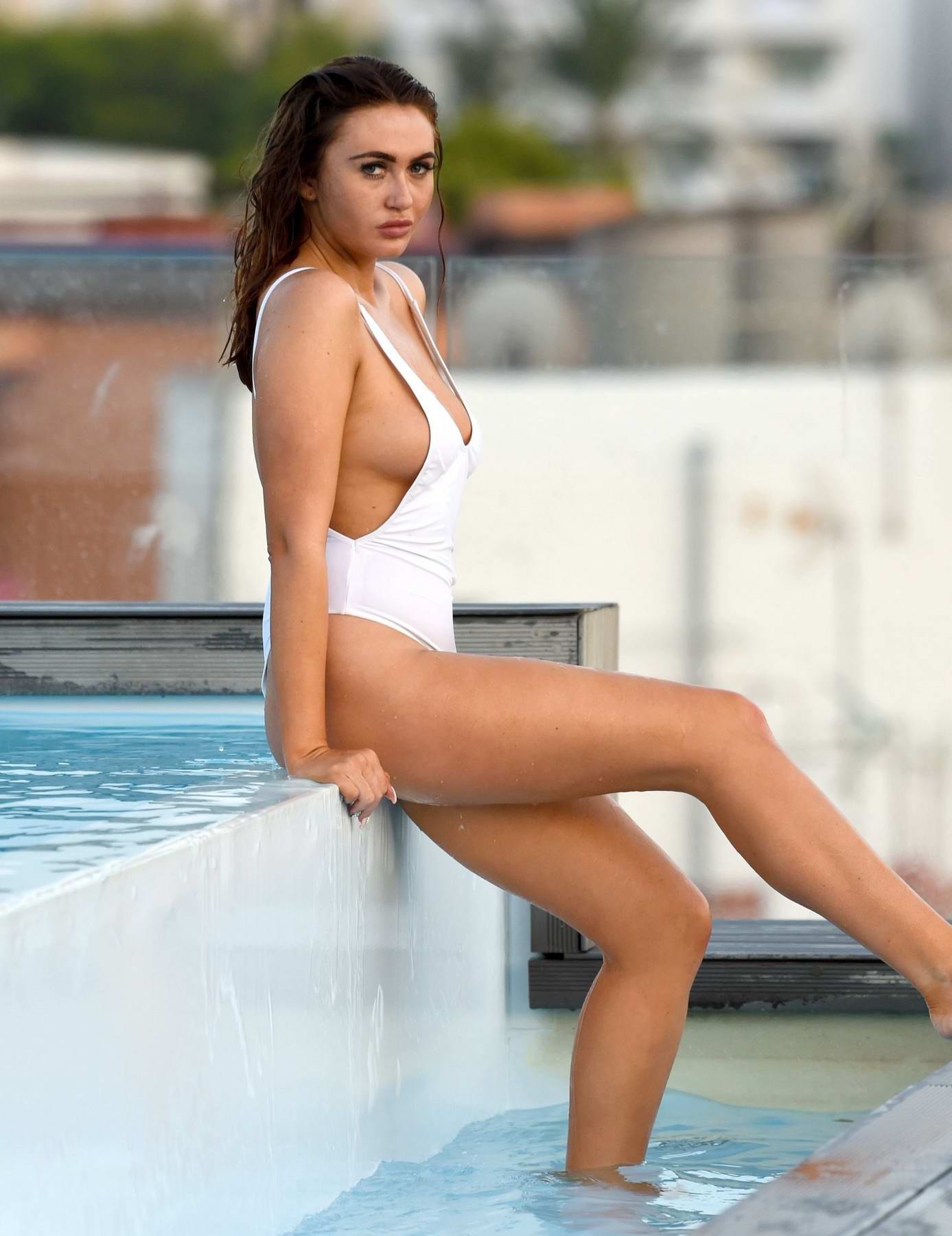 Charlotte Dawson in a white swimsuit for a photoshoot in Malaga, Spain
