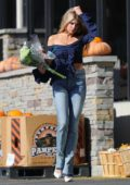 Charlotte McKinney stops to buy flowers on the way to the Bel Air Hotel in Los Angeles