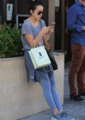 Chloe Bennet checks messages her phone as she leaves Thibiant Beverly Hills Medical Spa, Los Angeles