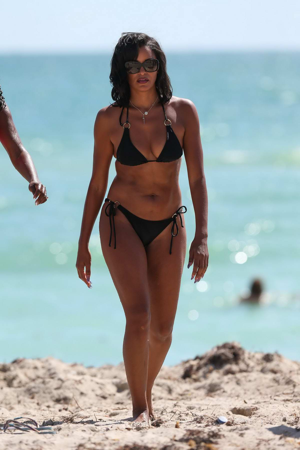 Claudia Jordan in a black bikini enjoying the ocean in Miami Beach, Florida