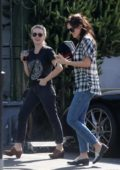 Dakota Johnson in a plaid shirt grabs coffee with Addison Timlin in West Hollywood, Los Angeles