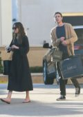 Dakota Johnson shops at Barney's with a mystery man in Beverly Hills, Los Angeles