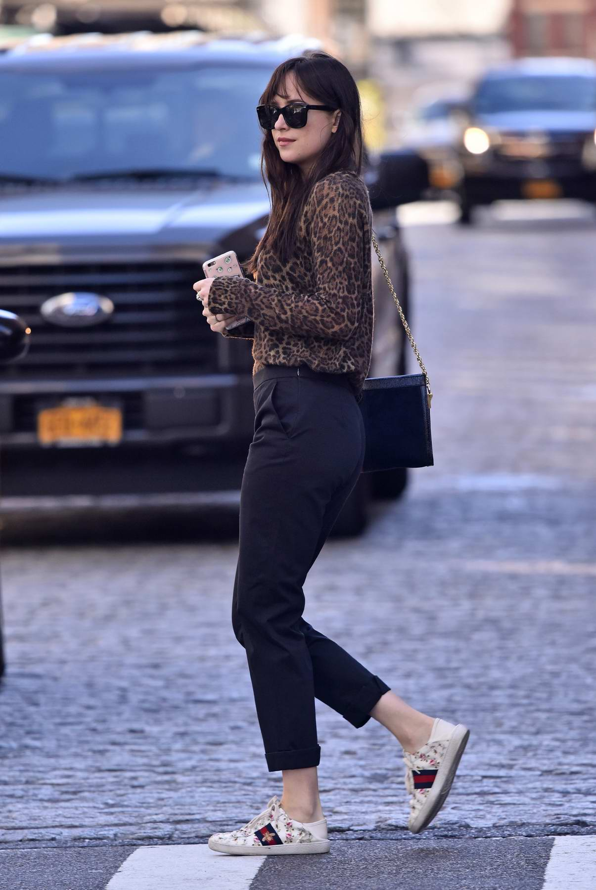 789041f39 dakota johnson wears a leopard top paired with gucci white sneakers while  crossing the street in new york city-021017_1