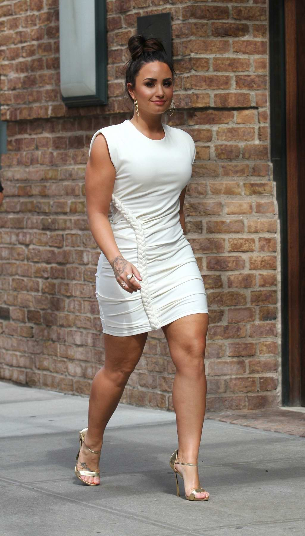 Demi Lovato in a short white dress out and about in Tribeca, New York