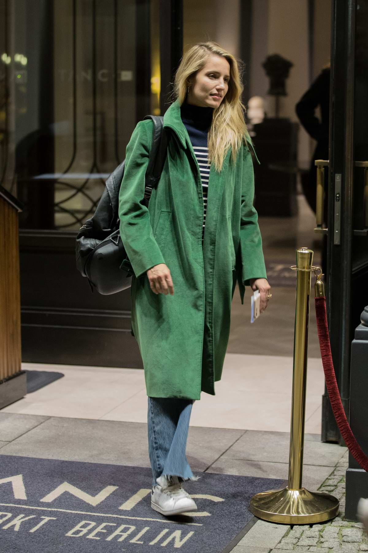 Dianna Agron seen in a green coat arriving at the Titanic Hotel after a long shooting day for 'Berlin I Love You' in Berlin, Germany