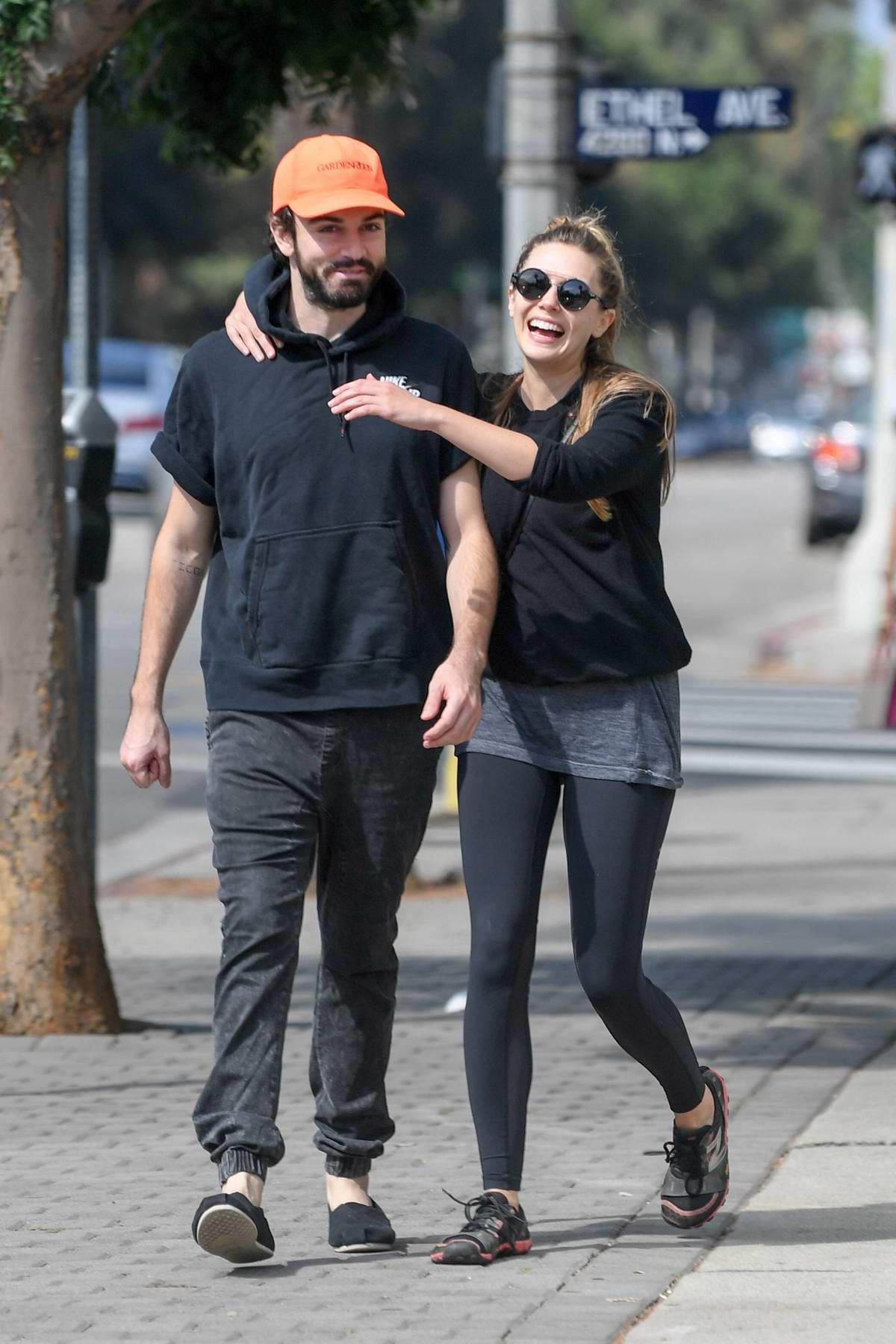 Elizabeth Olsen packs on some PDA with her musician boyfriend Robbie Arnett in Los Angeles