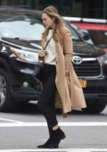 Elizabeth Olsen wears a beige coat while she runs some errands in New York City