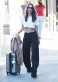 Emily Ratajkowski arrives at LAX Airport to catch a flight out of Los Angeles