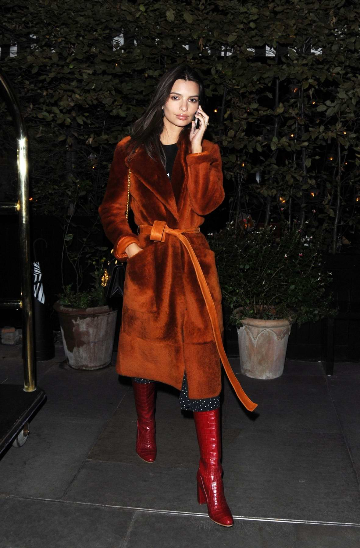 Emily Ratajkowski busy on her phone while leaving the Chiltern Firehouse in London