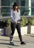 Eva Longoria with her leg strapped in a cast seen leaving Ken Paves Salon in West Hollywood, Los Angeles