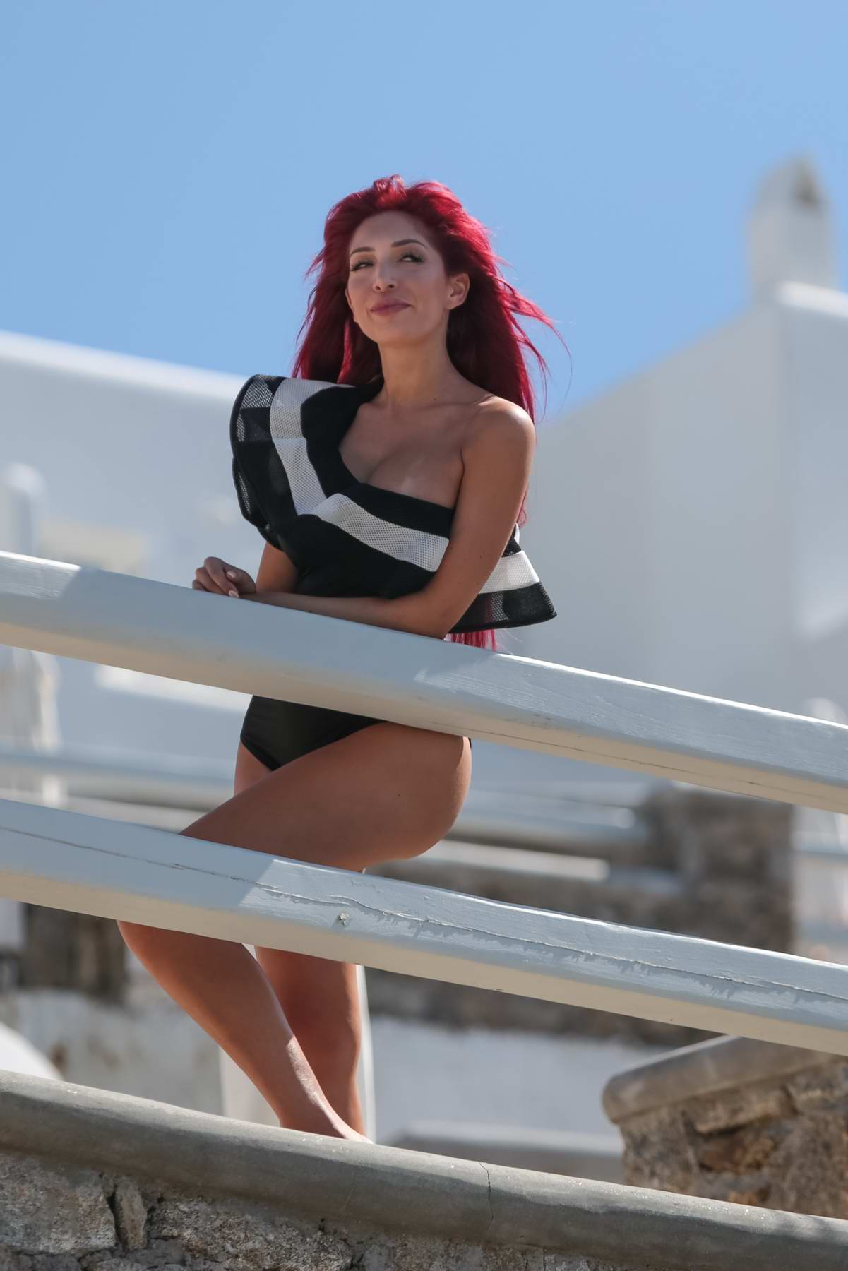 Farrah Abraham in a black swimsuit relaxing on a balcony during a holiday in Greece